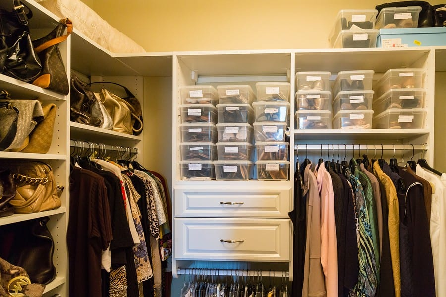 A well organized closet with custom shelves