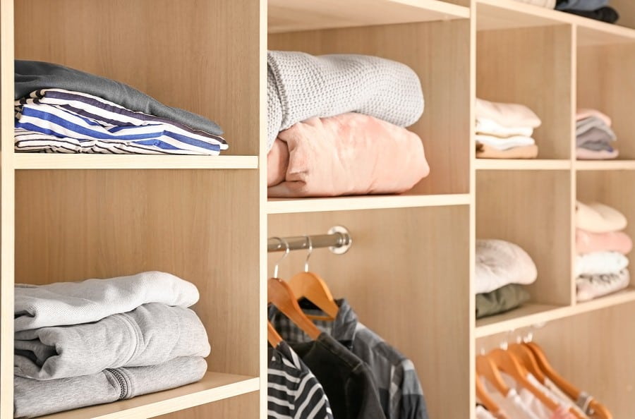Organized wardrobe closet with clothes