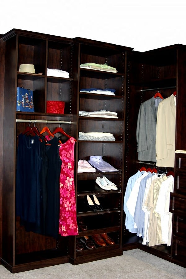 wooden upscale closet organizer with clothes