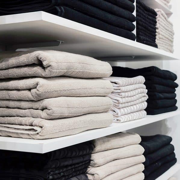 Organized custom linen closet shelving
