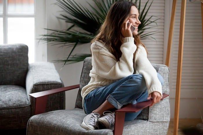 Woman on phone calling closet designer