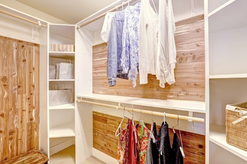 Neat And Beautiful Walk-in Closet With Clothes
