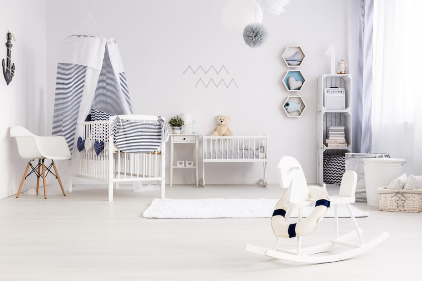 baby's room with rocking chair and closet